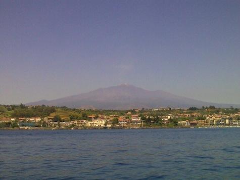 Mount Etna looms behind Calabria